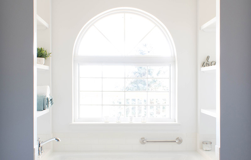 bathroom with large window by Looking Up Construction
